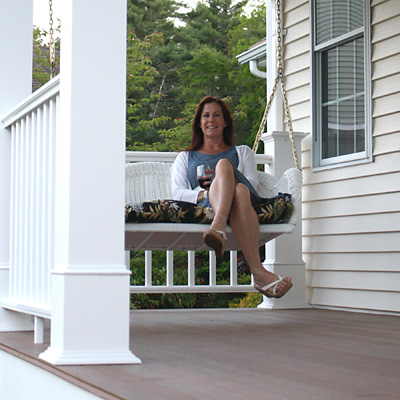 Deck with woman on a porch swing