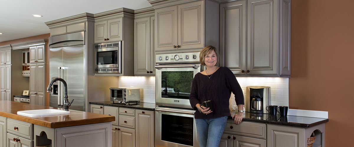 Sharon, MA Homeowner in kitchen designed by Amy Mood