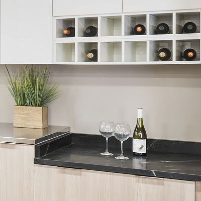 Wine rack and lower soapstone countertop in Metropolis kitchen display