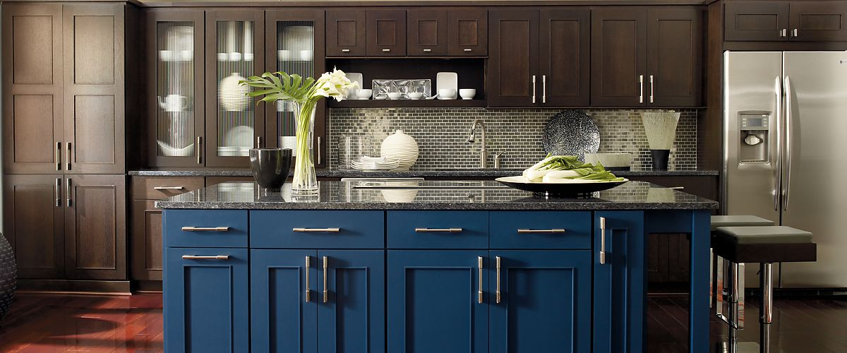Omega Cabinetry Contemporary Kitchen Dark Stained Cabinets With Blue Island