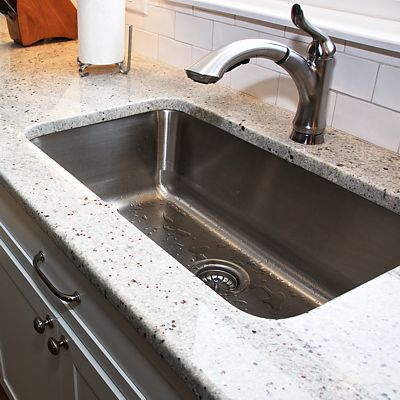 Kitchen island sink in South Kingstown, RI designed by Mary Jane Robillard