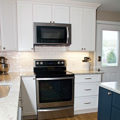 Kitchen island stove area in South Kingstown, RI designed by Mary Jane Robillard