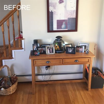 """Before"" - South Kingstown home, living room with table against the wall near the staircase"