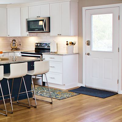Kitchen view3 stove and exterior door in South Kingstown, RI designed by Mary Jane Robillard