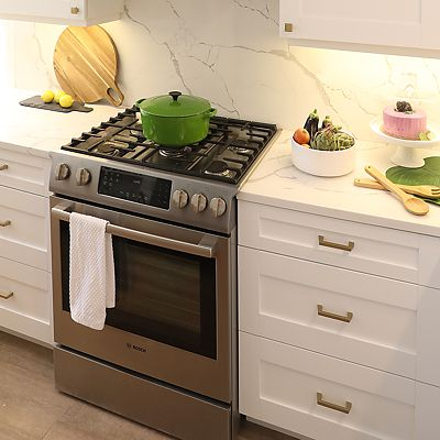 Cambridge, MA Kitchen Designed by Bob Russo – stove area lower cabinet drawers