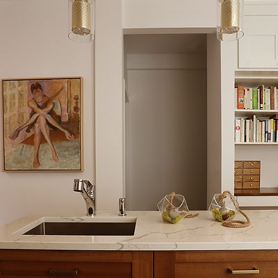 Cambridge, MA Kitchen Designed by Bob Russo – built-in storage shelves can be seen beyond the island