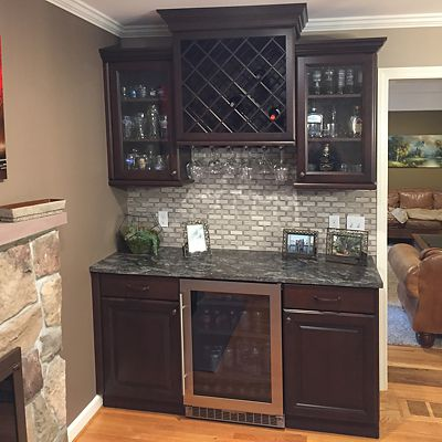 Entertainment beverage center with dark cabinetry designed by Josh Simmons