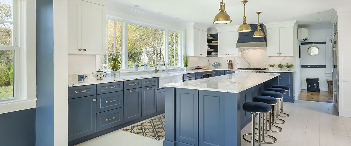Wide beauty shot of kitchen designed by Brandy Souza for home in Marion, MA