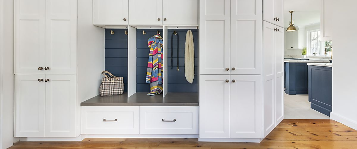 Mudroom near kitchen designed by Brandy Souza for home in Marion, MA
