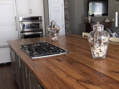 Sprague reclaimed wood island with gas cooktop