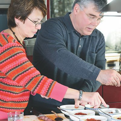 Ingrid and John Molnar preparing a meal together in their new kitchen