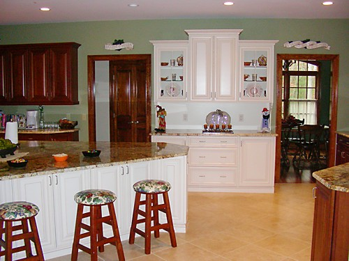 White kitchen island in Bellingham, MA kitchen designed by Jamie Thibeault