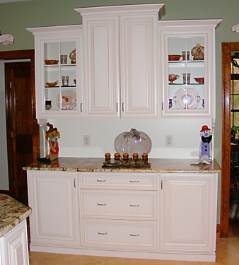Closeup of white hutch in Bellingham, MA kitchen designed by Jamie Thibeault