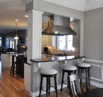 Stove area passthru in Foxboro, MA kitchen designed by Jamie Thibeault