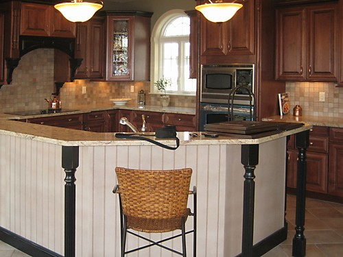 Two level island in North Attleboro, MA kitchen designed by Jamie Thibeault