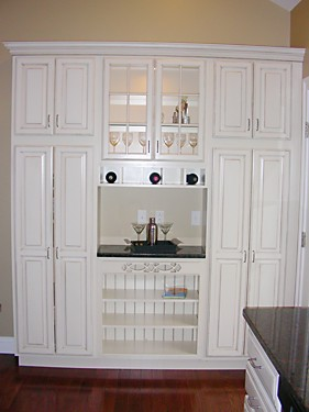Tall storage cabinets in Rockland, MA kitchen designed by Jamie Thibeault