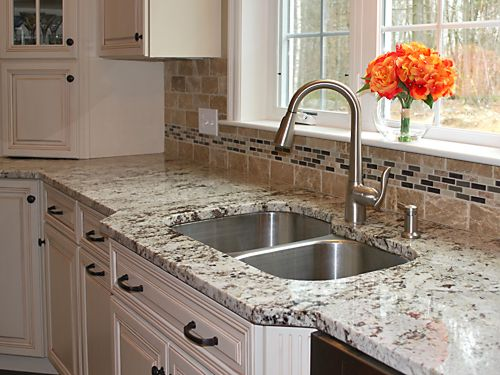 Closeup of sink area in Wrentham, MA kitchen designed by Jamie Thibeault