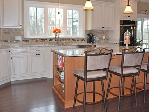 Island bookcase in Wrentham, MA kitchen designed by Jamie Thibeault