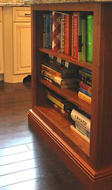 Island bookcase closeup in Wrentham, MA kitchen designed by Jamie Thibeault