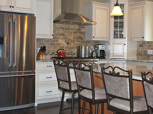 Refrigerator and Stove in Wrentham, MA kitchen designed by Jamie Thibeault