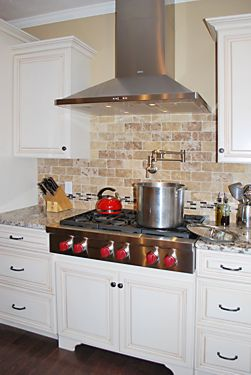 Stove closeup in Wrentham, MA kitchen designed by Jamie Thibeault
