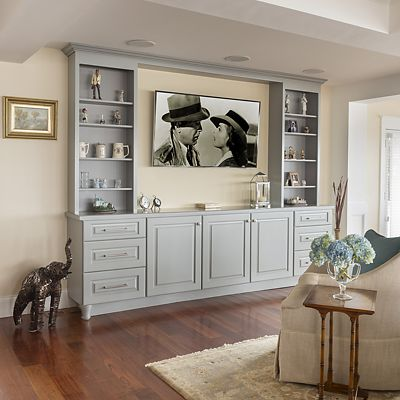 Entertainment center with display shelves and closed storage in Bristol, Rhode Island kitchen