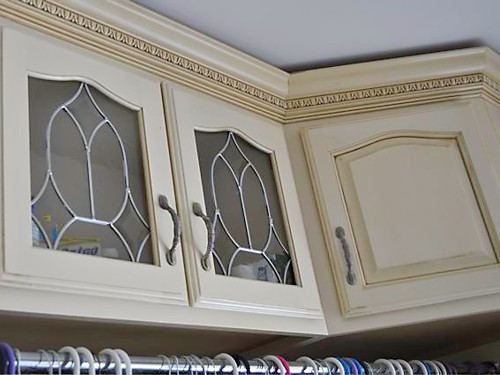 Glass Cabinet Doors in dressing room closet designed by Lisa Zompa